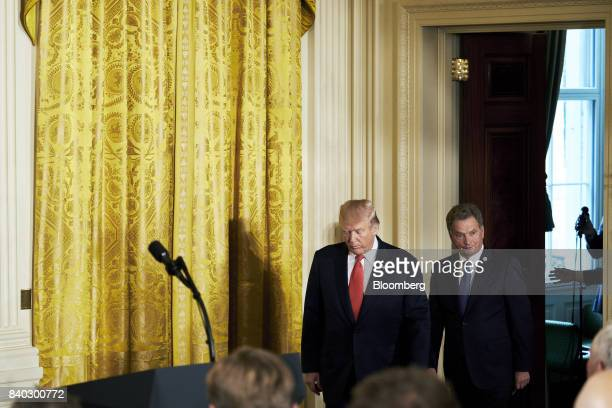 US President Donald Trump left and Sauli Niinisto Finland's president arrive for a joint press conference at the White House in Washington DC US on...