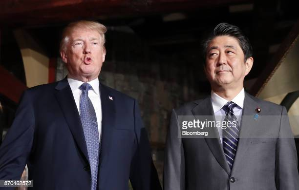 US President Donald Trump left and Shinzo Abe Japan's prime minister arrive at the UkaTei restaurant in Tokyo Japan on Sunday Nov 5 2017 Trump warned...