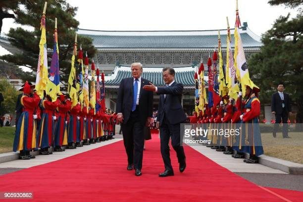 S President Donald Trump left and South Korean President Moon Jaein walk past an honor guard during a welcoming ceremony at the presidential Blue...