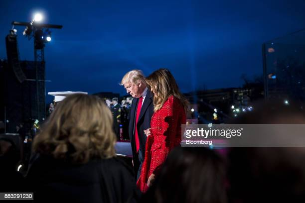 US President Donald Trump left and US First Lady Melania Trump attend the 95th Annual National Christmas Tree Lighting in Washington DC US on...