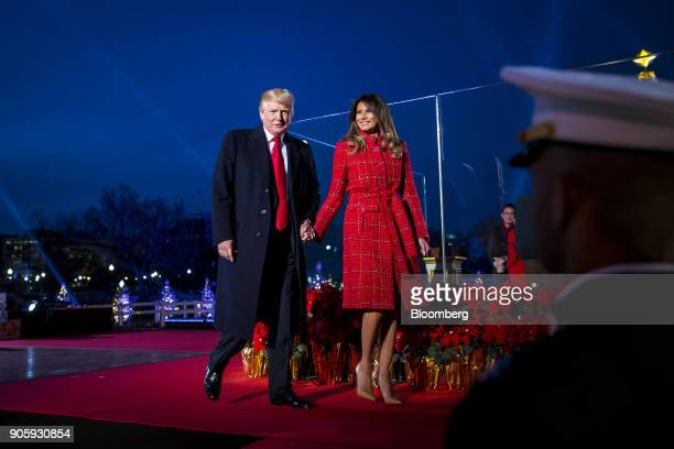 S President Donald Trump left and US First Lady Melania Trump attend the 95th Annual National Christmas Tree Lighting in Washington DC US on Thursday...