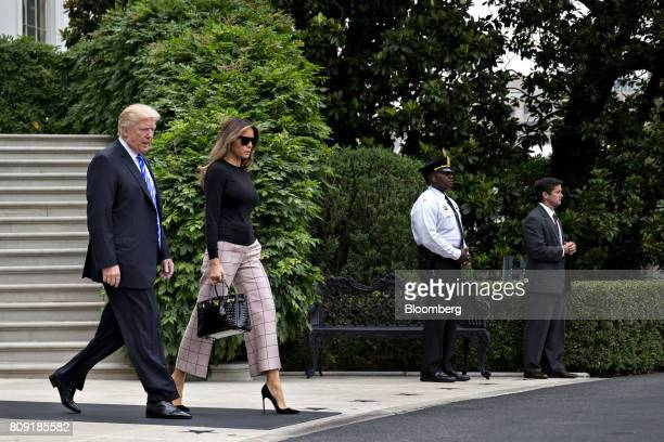 US President Donald Trump left and US First Lady Melania Trump walk out of the White House to board Marine One on the South Lawn in Washington DC US...