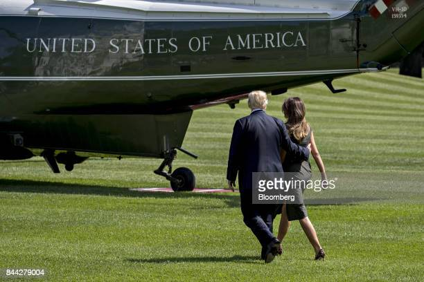 US President Donald Trump left and US First Lady Melania Trump walk to board Marine One on the South Lawn of the White House in Washington DC US on...