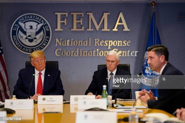 President Donald Trump, left, and Vice President Mike Pence listen as Acting Secretary of Homeland Security Chad Wolf speaks during a teleconference...