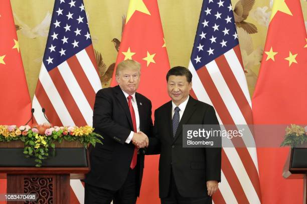 S President Donald Trump left and Xi Jinping China's president shake hands during a news conference at the Great Hall of the People in Beijing China...
