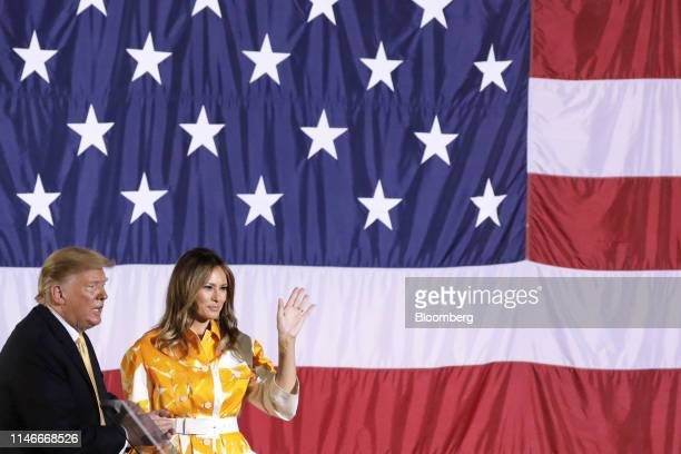 US President Donald Trump left applauds as First Lady Melania Trump waves to the US military personnel on board the USS Wasp aircraft carrier at the...