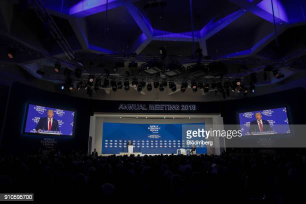 US President Donald Trump left delivers a special address as Klaus Schwab chairman of the World Economic Forum right sits on stage on the closing day...