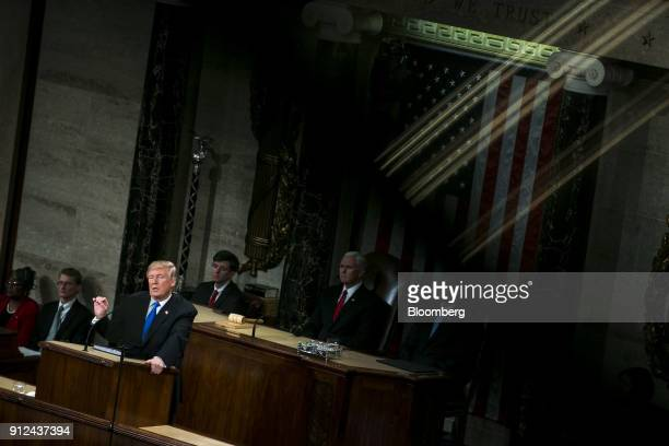 US President Donald Trump left delivers a State of the Union address to a joint session of Congress at the US Capitol in Washington DC US on Tuesday...