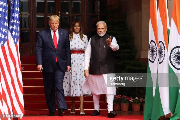 US President Donald Trump left First Lady Melania Trump center and Narendra Modi India's prime minister walk through Hyderabad House in New Delhi...