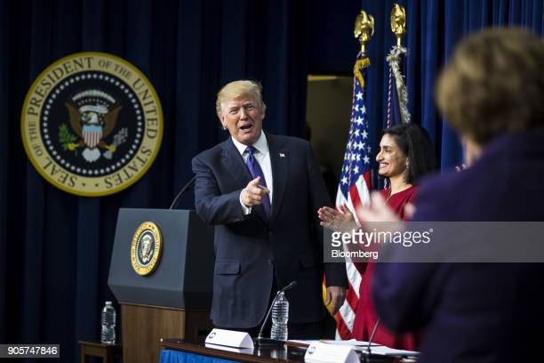 US President Donald Trump left gestures while speaking during a 'Conversations with the Women of America' event at the Eisenhower Executive Office...