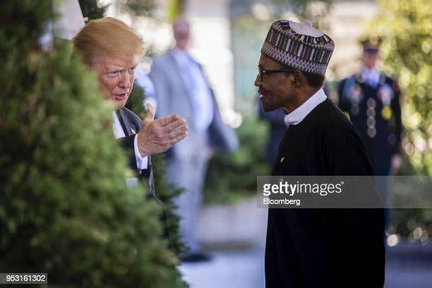 US President Donald Trump left greets Muhammadu Buhari Nigeria's president at the West Wing of the White House in Washington DC US on Monday April 30...