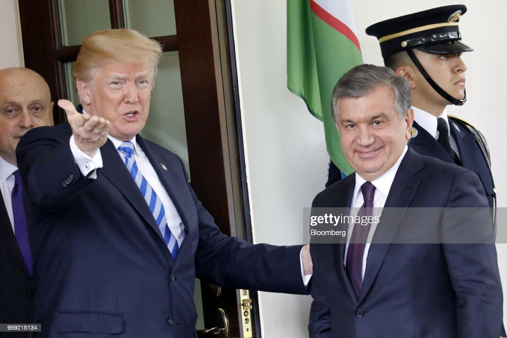 U.S. President Donald Trump, left, greets Shavkat Mirziyoev, Uzbekistan's president, ahead of a bilateral meeting at the White House in Washington, D.C., U.S., on Wednesday, May 16, 2018. Trump said he is working closely with Mirziyoev while discussing trade and military equipment. Photographer: Yuri Gripas/Bloomberg via Getty Images