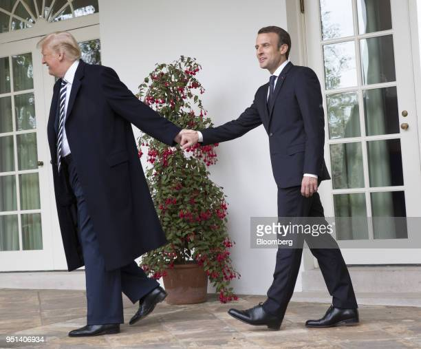 S President Donald Trump left leads Emmanuel Macron France's president towards the Oval Office during a state visit at the White House in Washington...