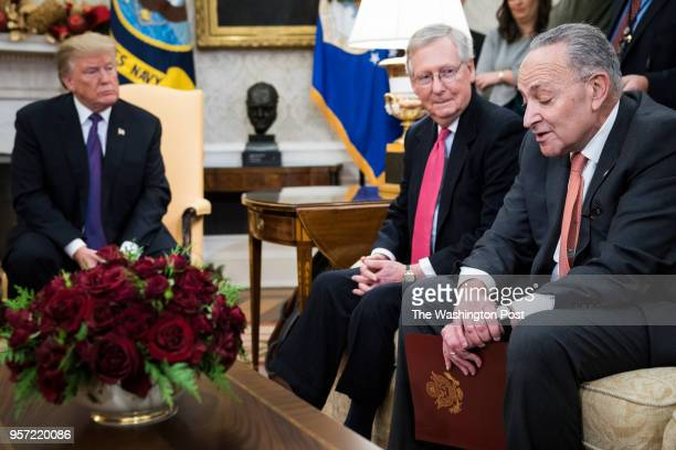 President Donald Trump left listens with Senate Majority Leader Mitch McConnell of Ky as Senate Minority Leader Chuck Schumer of NY speaks during a...
