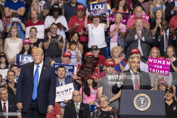 US President Donald Trump left looks on as Representative Lou Barletta a Republican from Pennsylvania speaks at the podium during a rally in...