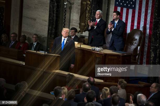 US President Donald Trump left pauses while delivering a State of the Union address to a joint session of Congress at the US Capitol in Washington DC...