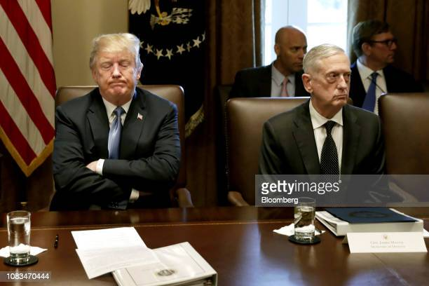 S President Donald Trump left pauses while speaking as James Mattis US secretary of defense listens during a Cabinet meeting at the White House in...