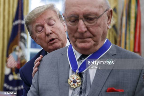 US President Donald Trump left presents the Presidential Medal of Freedom to Robert Cousy former National Basketball Association player for the...