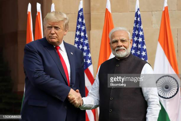 President Donald Trump, left, shakes hand with Narendra Modi, India's prime minister, as they pose for photographers at Hyderabad House in New Delhi,...