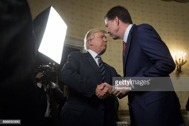US President Donald Trump left shakes hands with James Comey director of the Federal Bureau of Investigation during an Inaugural Law Enforcement...