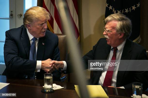 US President Donald Trump left shakes hands with John Bolton national security advisor during a meeting with senior military leadership in the...