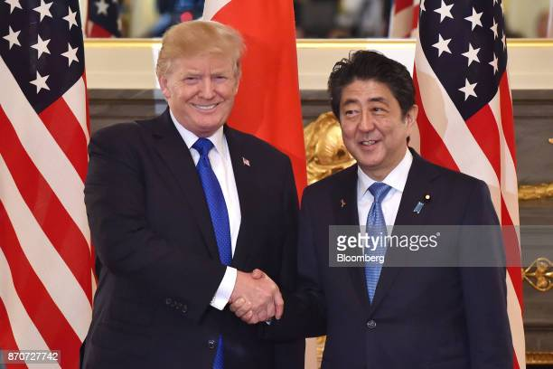 U S President Donald Trump left shakes hands with Shinzo Abe Japan's Prime Minister ahead of a summit meeting at Akasaka Palace in Tokyo Japan on...