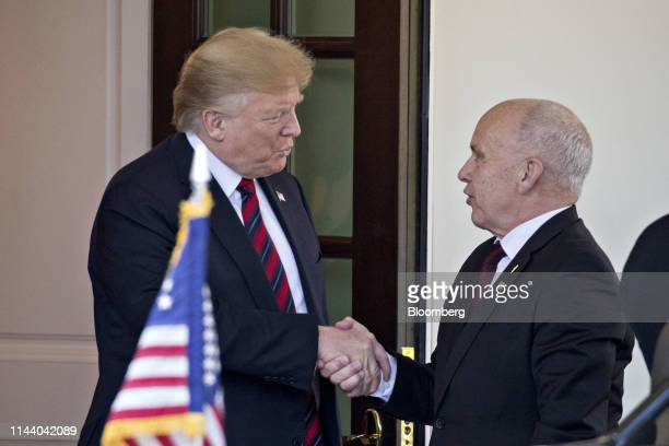 US President Donald Trump left shakes hands with Ueli Maurer Switzerland's finance minister at the West Wing of the White House in Washington DC US...