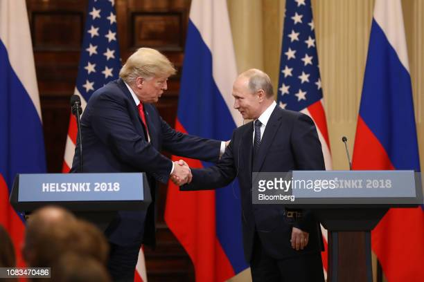 S President Donald Trump left shakes hands with Vladimir Putin Russia's President during a news conference in Helsinki Finland on Monday July 16 2018...