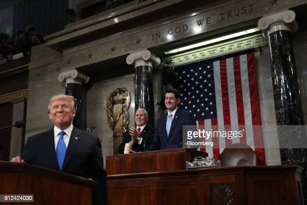 US President Donald Trump left smiles before delivering a State of the Union address to a joint session of Congress at the US Capitol in Washington...