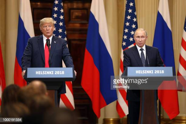US President Donald Trump left receives a soccer ball from Vladimir Putin Russia's president during a news conference in Helsinki Finland on Monday...