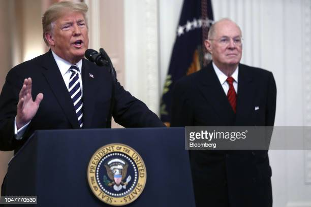 US President Donald Trump left speaks as Anthony Kennedy former associate justice of the US Supreme Court listens during a ceremonial swearingin...