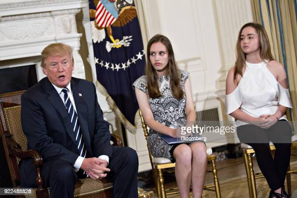 US President Donald Trump left speaks as Carson Abt center and Ariana Klein students from Marjory Stoneman Douglas High School participate in a...