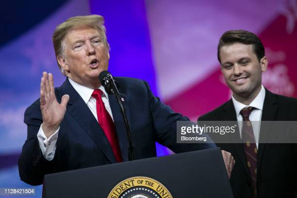 US President Donald Trump left speaks as Hayden Williams a member of the Leadership Institute listens during the Conservative Political Action...