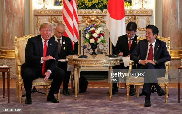President Donald Trump, left, speaks as he meets Japanese Prime Minister Shinzo Abe at Akasaka Palace, Japanese state guest house on May 27, 2019 in...