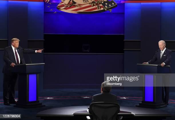 President Donald Trump, left, speaks as Joe Biden, 2020 Democratic presidential nominee, listens during the first U.S. Presidential debate hosted by...