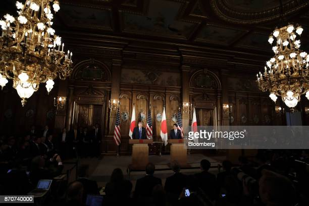 US President Donald Trump left speaks as Shinzo Abe Japan's prime minister during a news conference at Akasaka Palace in Tokyo Japan on Monday Nov 6...