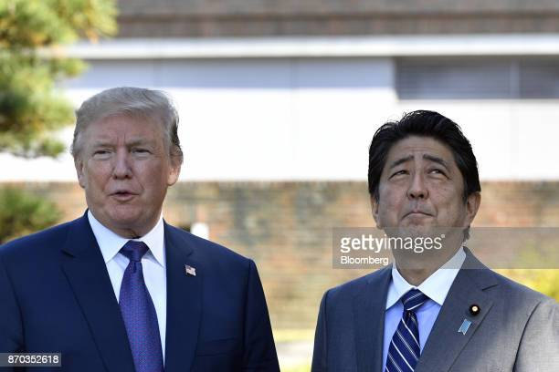 US President Donald Trump left speaks as Shinzo Abe Japan's prime minister looks on at Kasumigaseki Country Club in Kawagoe Saitama Japan on Sunday...
