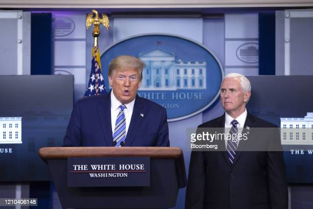 US President Donald Trump left speaks as US Vice President Mike Pence listens during a news conference at the White House in Washington DC US on...