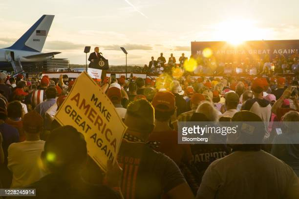 President Donald Trump, left, speaks during a campaign rally at the Pro Star Aviation hangar in Londonderry, New Hampshire, U.S., on Friday, Aug. 28,...