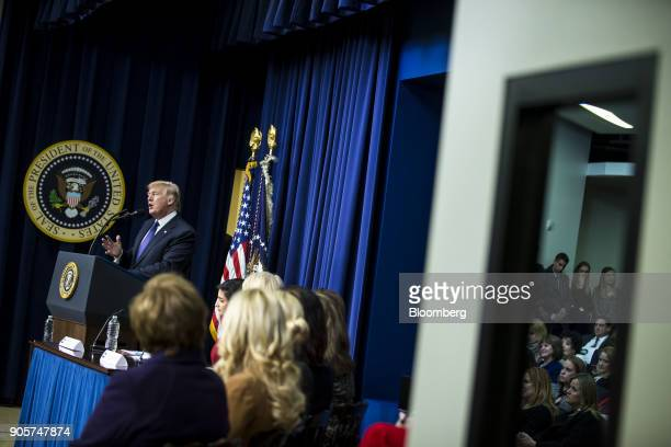 US President Donald Trump left speaks during a 'Conversations with the Women of America' event at the Eisenhower Executive Office Building in...