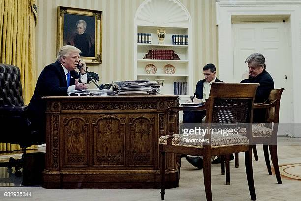 US President Donald Trump left speaks on the phone with Malcolm Turnbull Australia's prime minister as retired Lieutenant General Michael Flynn US...