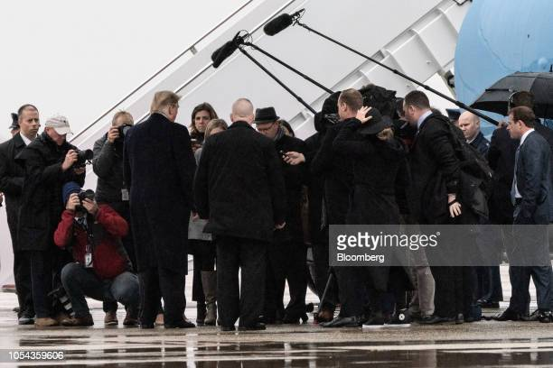 US President Donald Trump left speaks to members of the media before boarding Air Force One at Joint Base Andrews Maryland US on Saturday Oct 27 2018...