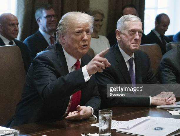 US President Donald Trump left speaks while Jim Mattis US Secretary of Defense listens during a cabinet meeting at the White House in Washington DC...