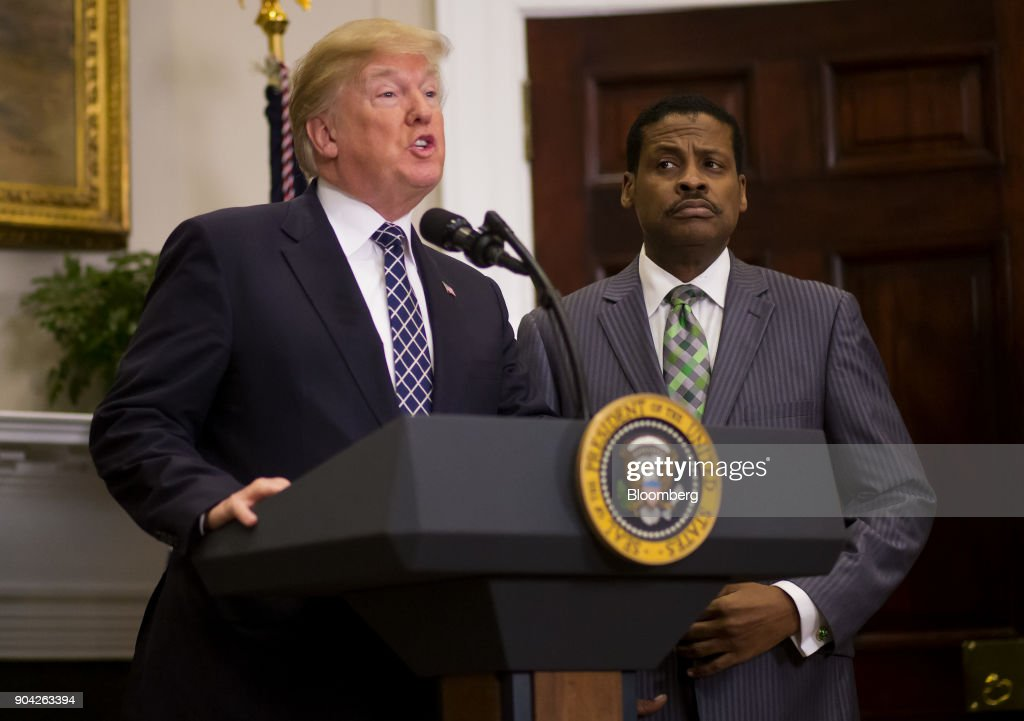U.S. President Donald Trump, left, speaks while Martin Luther King Jr.'s nephew Isaac Newton Farris Jr., chief executive officer of the Martin Luther King Jr. Center for Non-Violent Social Change, listens before the signing of a proclamation in the Roosevelt Room of the White House in Washington, D.C., U.S., on Friday, Jan. 12, 2018. Trump blew up negotiations on a potential immigration deal, pushing both sides to harden their positions and raising the risks that the standoff will sink talks aimed at averting a government shutdown at the end of next week. Photographer: Eric Thayer/Bloomberg via Getty Images