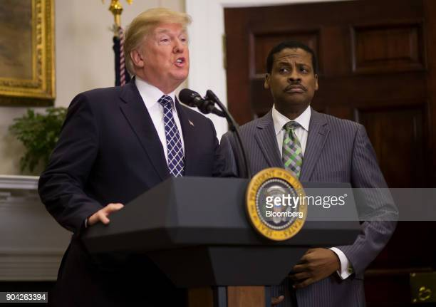 US President Donald Trump left speaks while Martin Luther King Jr's nephew Isaac Newton Farris Jr chief executive officer of the Martin Luther King...