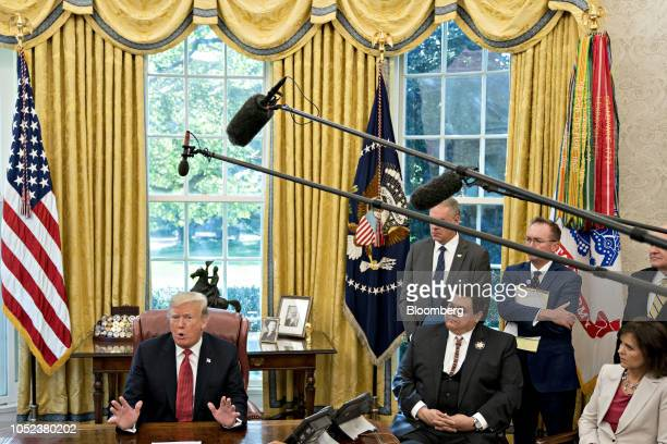 US President Donald Trump left speaks while meeting with workers in the Oval Office of the White House during a 'Cutting the Red Tape Unleashing...
