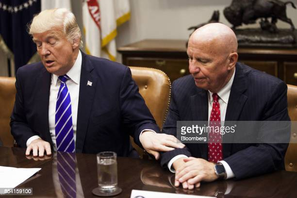 US President Donald Trump left speaks while Representative Kevin Brady a Republican from Texas and chairman of the House Ways and Means Committee...