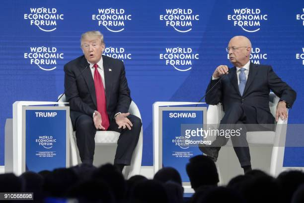 US President Donald Trump left speaks with Klaus Schwab chairman of the World Economic Forum during a special address on the closing day of the World...