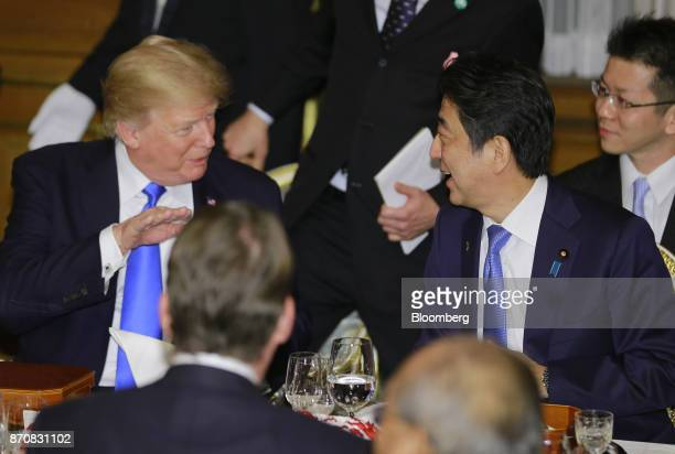 US President Donald Trump left speaks with Shinzo Abe Japan's prime minister during a state banquet at Akasaka Palace in Tokyo Japan on Monday Nov 6...