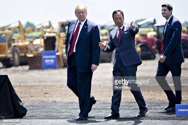 US President Donald Trump left speaks with Terry Gou chairman of Foxconn Technology Group after the groundbreaking ceremony for the Foxconn facility...